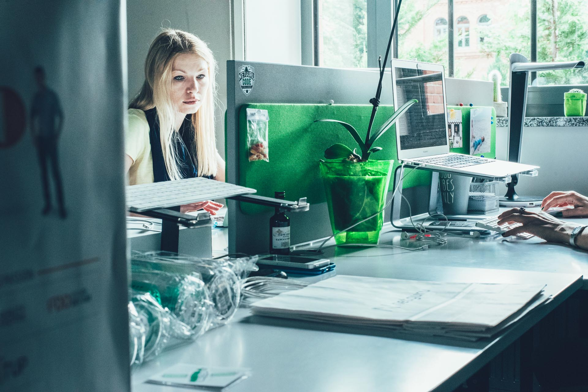 Woman working in front of a desktop